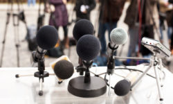 Photo: Microphones and recorder at a press conference